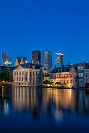 the hague: Binnenhof Palace of Parliament inThe Hague in The Netherlands Shot During Blue Hour Time. Against Modern Skyscrapers on Background. Vertical Image