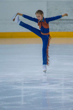 crossover: Minsk, Belarus -April 23, 2017: Unidentified Female Figure Skater performs Chicks Ladies Free Skating Program at Minsk Arena Cup 2017 International Figure Skating Competition in April 23,  2017 in Minsk, Belarus Editorial