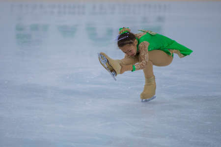 Minsk, Belarus -April 23, 2017: Unidentified Female Figure Skater performs Chicks Ladies Free Skating Program at Minsk Arena Cup 2017 International Figure Skating Competition in April 23,  2017 in Minsk, Belarus Editorial