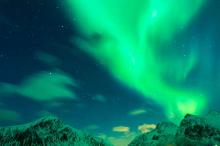 ionosphere: Aurora Borealis Known as Nother Lights Playing with Vivid Colors Over Lofoten Islands in Norway. Horizontal Image Orientation