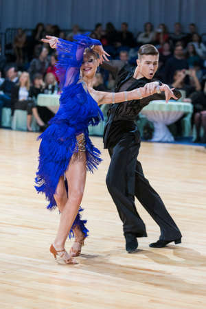 latinamerican: Minsk, Belarus-February 18, 2017: Couple of Danila Shmidt and Buldyk Arina Performs Youth Latin-American Program on WDSF Minsk Open Dance Festival-2017 Championship in February 18, 2017 in Minsk, Belarus. Editorial