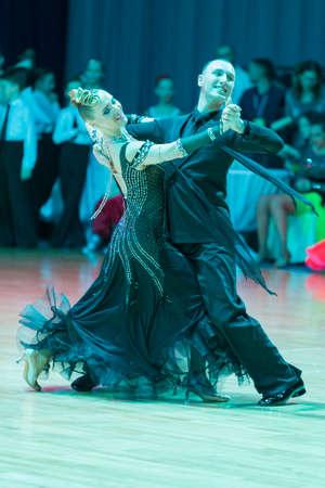 Minsk, Belarus-February 19, 2017: Pro-Am Dance Couple Performs Pro-Am Super Cup International European Standard Program on WDSF Minsk Open Dance Festival-2017 on February 19, 2017 in Minsk, Belarus.