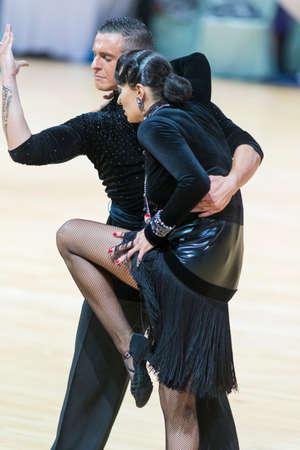 Minsk, Belarus-February 18, 2017: Unidentified Pro-Am Couple Performs Pro-Am Super Cup International Latin Program on WDSF Minsk Open Dance Festival-2017 Championship in February 18, 2017 in Minsk, Belarus.