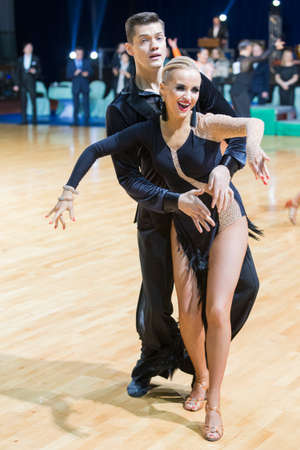 latinamerican: Minsk, Belarus-February 19, 2017: Unidentified Professional Dance Couple Performs Adults Latin-American Program on WDSF Minsk Open Dance Festival-2017 on February 19, 2017 in Minsk, Belarus.