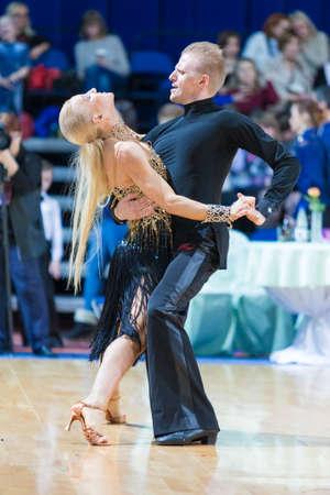 Minsk, Belarus-February 18, 2017: Pro-Am Couple of Ivan Miskevich and Svetlana Rodina Performs Pro-Am Super Cup International Latin Program on WDSF Minsk Open Dance Festival-2017 Championship in February 18, 2017 in Minsk, Belarus.