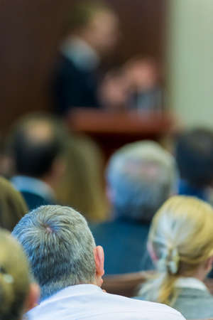 Blurred Silhouettes of Business People Listening to The Lecturer in Front.Vertical Image Stock Photo