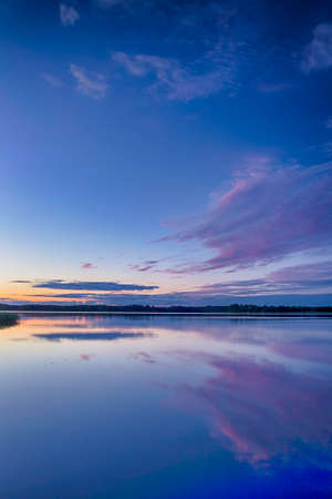 Travel Concepts and Ideas. Belarussian National Park Braslav Lakes at Sunset during Summertime. Vertical Image Composition