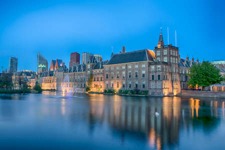Binnenhof Palace of Parliament inThe Hague in The Netherlands Shot During Blue Hour Time. Against Modern Skyscrapers on Background. Horizontal Image