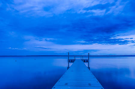 Picture of Separate Empty Boat Pier on Braslav Lake.Picture taken During Blue Hour. Horizontal Image