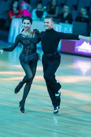 Minsk,Belarus-October 7,2017:Pro-Am Dance Couple of Yury Simachev and Oksana Kagno Performs Pro-Am Cup International Scholarship Latin-American Program on WDSF International Capital Cup Minsk in October 7,2017 in Minsk,Belarus