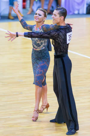 Minsk, Belarus-October 28, 2017: Dance Couple Of Ilia Shvaunov and Anna Sneguir Performs Youth-2 Latin-American Program on WDSF International WR Dance Cup in October 28, 2017, in Minsk, Republic of Belarus