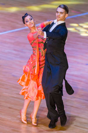 Minsk, Belarus –October 29, 2017: Professional Dance Couple Perform Youth Standard European Program on the WDSF International WR Dance Cup in October 29, 2017 in Minsk, Republic of Belarus Editorial