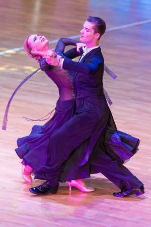 Minsk,Belarus –October 29,2017:Professional Dance Couple of Anna Sneguir and Ilia Shvaunov Performs Youth Standard Program on WDSF International WR Dance Cup in October 29, 2017 in Minsk,Belarus