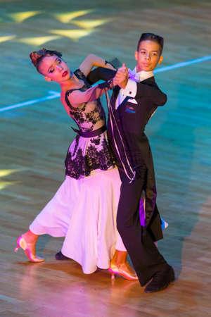 Minsk, Belarus –October 29, 2017: Professional Dance Couple Perform Youth Standard European Program on the WDSF International WR Dance Cup in October 29, 2017 in Minsk, Republic of Belarus Editorial