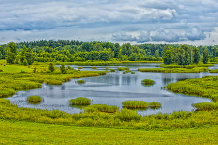 Travel Concepts and Ideas. Belarussian National Park Braslav Lakes Surrounded by Densely Forested Area at Noon During Summertime.Horizontal Image