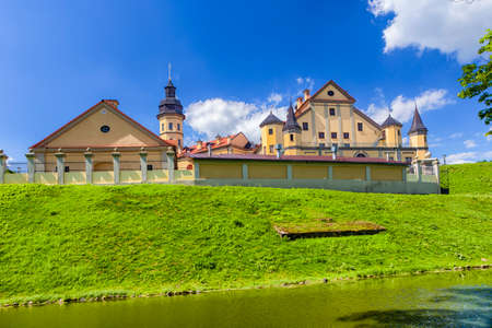 Famous Tourist Destinations.Backside of  Renowned Nesvizh Castle on The Moat as a Profound Example of Medieval Ages Heritage and Residence of the Radziwill Family.Horizontal Shot Editorial