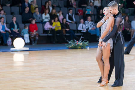 Minsk,Belarus – December 17,2017: Professional Dance Couple Performs Youth Latin-American Program on WDSF International Championship Alliance Trophy in December 17, 2017 in Minsk, Belarus Editorial