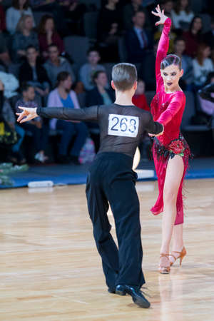 Minsk, Belarus-October 7, 2017: Professional Dance Couple Performs Youth-2 Latin-American Program on Alliance Trophy WDSF International Championship in December 17, 2017, in Minsk, Belarus. Editorial