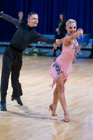 Minsk,Belarus – December 17,2017: Professional Dance Couple Performs Youth Latin-American Program on WDSF International Championship Alliance Trophy in December 17, 2017 in Minsk, Belarus