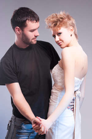 Relationships Concepts. Young Caucasian Couple Posing Together and Embracing.