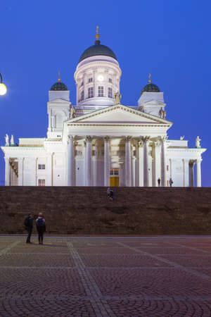 Travel Ideas and Concepts. Renowned Lutheran Cathedral in Helsinki on Senate Square Shot During Blue Hour in Finland.Vertical Image Composition