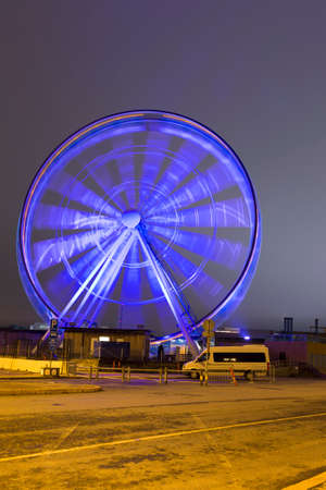 Travel Destinations. The Helsinki Skywheel in Finland, Shot Using Long Shutter Speed at Night. During Christmas Time. Vertical Image Composition