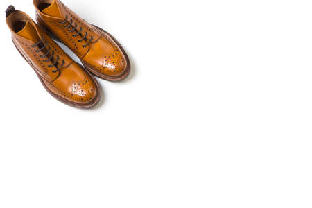 Footwear Ideas. Pair Of Separate Luxury Tan Brogue Boots On Pure White Background with Copy Space.Horizontal Image