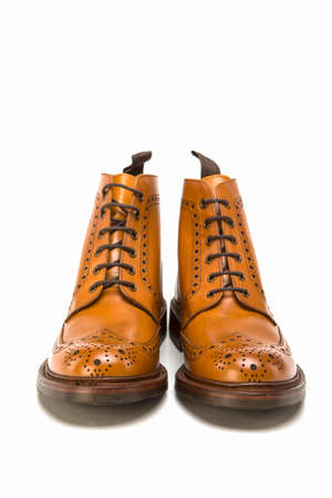 Male Footwear Ideas. Pair of  Premium Tanned Brogue Derby Boots Made of Calf Leather with Rubber Sole. Isolated Over Pure White Background. Vertical Image