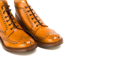 Footwear Ideas. Closeup of Pair of  Premium Tanned Brogue Derby Boots Made of Calf Leather with Rubber Sole. Isolated Over Pure White Background. Horizontal Image