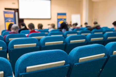 Business Meetings Concepts. Group of People in Congress Hall Prior to the Meeting Start.Horizontal Image Orientation