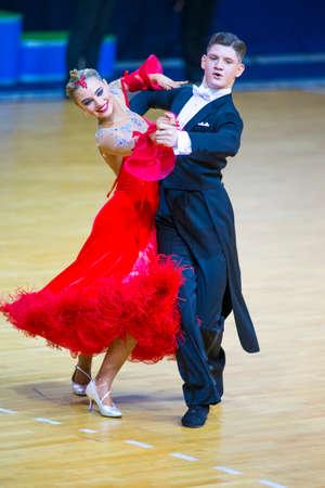 Minsk-Belarus, March 11, 2018: Dance Couple of Michail Maidanyuk and Olga Shimanskaya Performs Youth Standard European Program on WDSF National Championship of the Republic of Belarus in March 11, 2018 in Minsk, Belarus Redactioneel