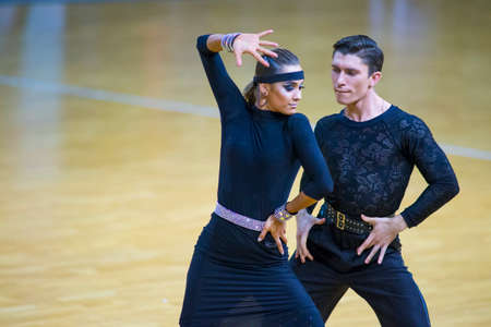 Minsk-Belarus, March 11, 2018: Dance Couple Performs Adult Latin –American Program on WDSF National Championship of the Republic of Belarus in March 11, 2018 in Minsk, Belarus 版權商用圖片 - 103271949