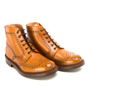 Shoes Concepts. Premium Tanned Brogue Derby Boots of Calf Leather with Rubber Sole. Isolated Over Pure White. Horizontal Image Orientation