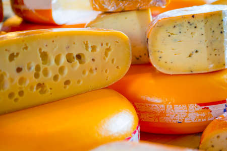 Vegan eating Ideas and Concepts. Closeup of Traditional Dutch Cheese Cut in Two halves On Market Display.Horizontal Image Composition
