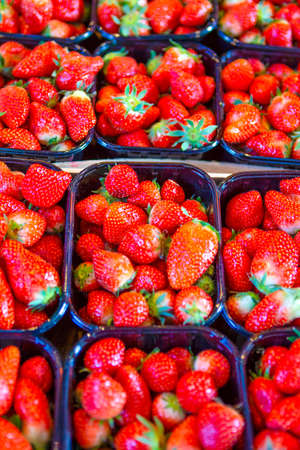 Healthy Eating Concepts. Closeup of Fresh Strawberries in Separate Boxes Placed on Market Display.Vertical Shot