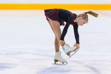 Minsk, Belarus –April 22, 2018: Female Figure Skater Performs Girls Free Skating Program at Minsk Arena Cup 2018 in April 22, 2018, in Minsk, Belarus Imagens - 100997249