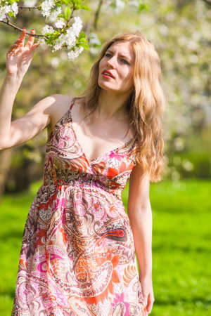 Portrait of Sensual Dreaming Blond in Spring Forest Outdoors.Vertical image Orientation