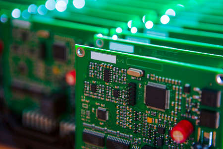 Modern Electronics Ideas. Closeup of Lot of Electronic Printed Circuit Boards with Lots of Surface Mounted Components.Horizontal Shot Stock fotó