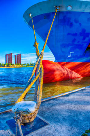 Maritime Transportation Concepts. Closeup of Two Mooring Ropes From Foredeck of Sea Tanker Moored at Pier of Rotterdam. Vertical Image Stock Photo