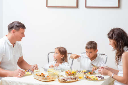 Family Concepts and Ideas of Combined Eating. Happy Parents with Their Children Having Breakfast at Home Together. Horizontal Shot