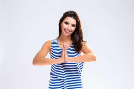 Portrait of Caucasian Brunette Girl in Sweatshirt.Posing in Yoga Pose Against White. Horizontal Image