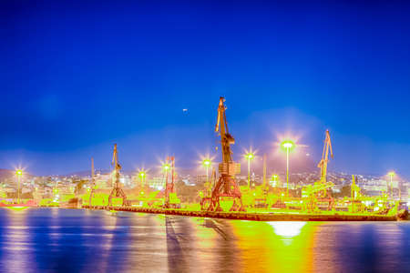 Port Cranes Working in Heraklion City in Greece at Blue Hour Time.Horizontal Image