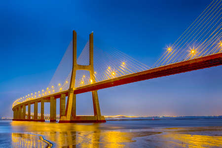 Famous Vasco Da Gama Bridge in Lisbon in Portugal. Picture Made During Blue Hour. Horizontal Image Composition