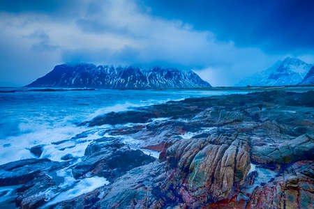 Amazing and Picturesque Norwegian Skagsanden Beach At Early Spring Time. Splashes of Ocean Waves.Horizontal Image Orientation