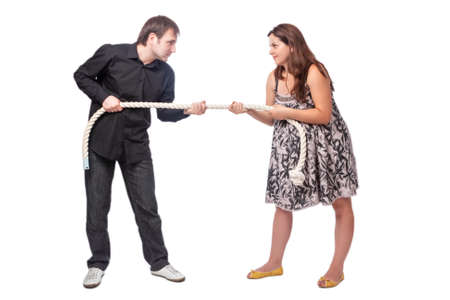 Young Caucasian Couple Towing a Rope To Each Other. Concept of Separation and Divorce.Horizontal Image