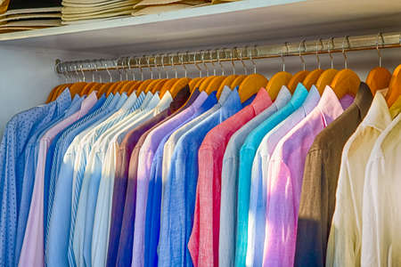 Line of Colorful Linen Summer long Sleeve Shirts Placed on Hangers in Store of Oia Village in Santorini Island in Greece.Horizontal Shot Stok Fotoğraf