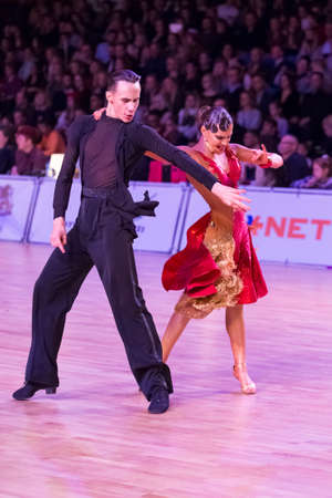Riga, Latvia-December 15, 2018: Professional Adult Dance Couple Performs Youth Latin-American Program on the WDSF Baltic Grand Prix-2108 Championship in December 15, 2018 in Riga, Latvia