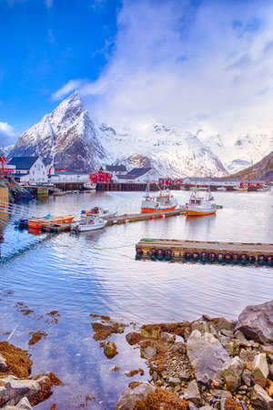 Traditional Norwegian Fishing Village Ã… in Lofoten, Norway Shot from Marina at Hamnoy. Vertical Image Composition Stockfoto