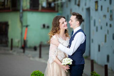 Happy Caucasian Wedding Couple Kissing Together on Street.Horizontal Image