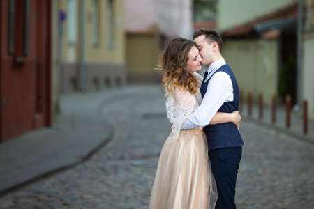 Happy Wedding Caucasian Couple Embracing Outdoors on Lonely Street.Horizontal Image